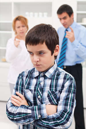 Parents punishing his sad child Stock Photo