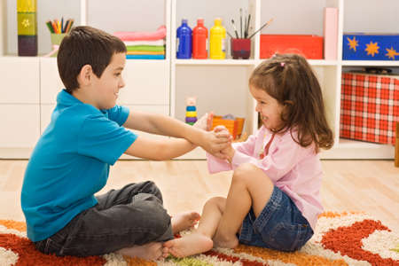 Two happy children playing on the floor Stock Photo - 17108190