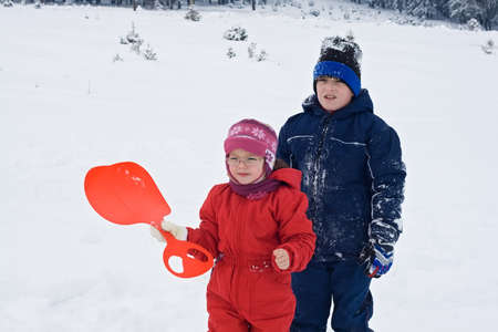 Two children staying in the snow Stock Photo