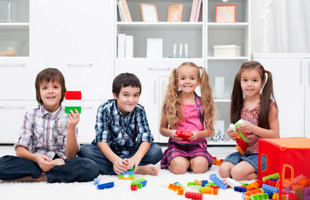 play room: Happy children playing with blocks