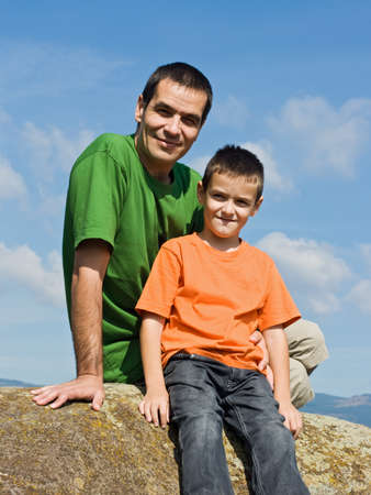 Father and his son sitting on the stone Stock Photo - 17218729