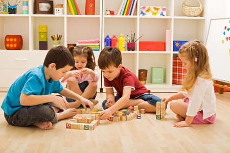 Children playing with blocks on the floor Stock Photo - 17390784