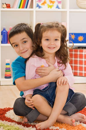 Little boy embracing his sister, focus on the boy Stock Photo - 17480155