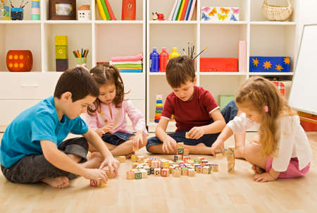 Children playing with blocks on the floor Stock Photo - 17480162