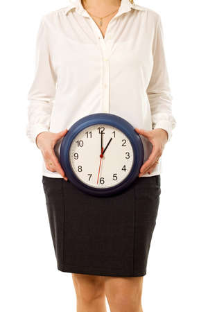 Businesswoman holding a wall clock - isolated