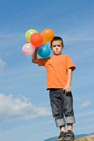 Boy imitates the inflated balloons
