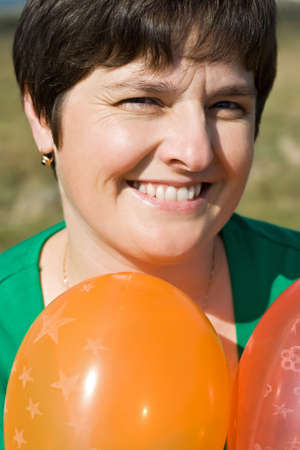 Beautiful happy woman with balloons Stock Photo - 17505017