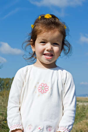 Happy little girl in white clothes Stock Photo