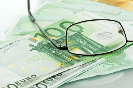 Eyeglasses and currencies