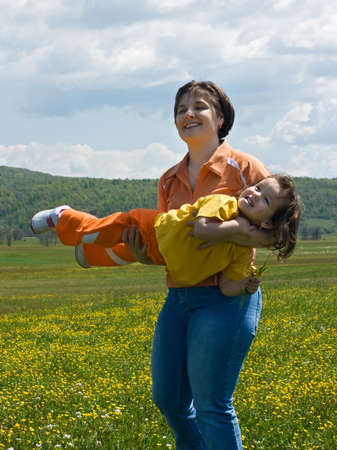 Mother and her daughter having fun in the field