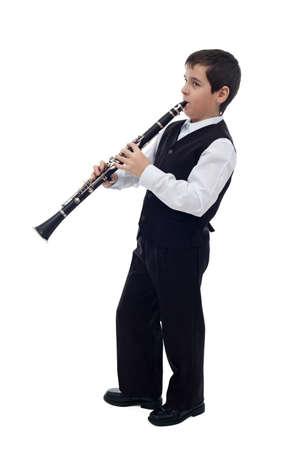 clarinete: Niño pequeño que juega en el clarinete Foto de archivo
