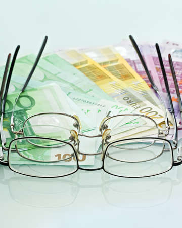 Eyeglasses and currencies photo