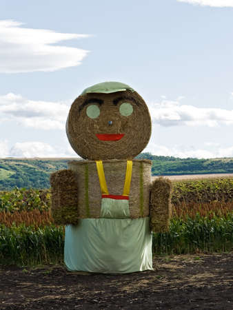 Huge straw man staying on the field Stock Photo