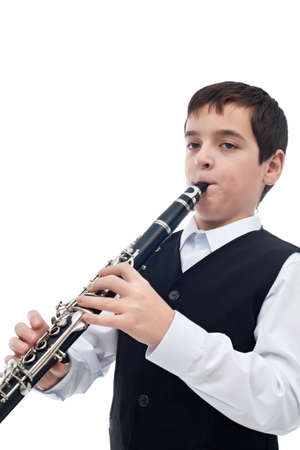 Little artist playing on the clarinet