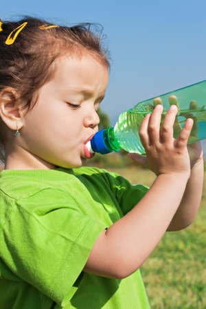 Little girl drinking fresh water Stock Photo