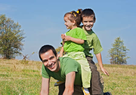 Father and his children playing outside Stock Photo