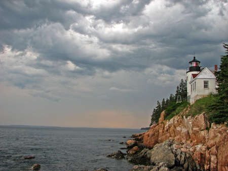 Storm approaches at Bass Harbor Head Lighthouse, Mount Desert Island, Acadia National Park, Maine, New England.