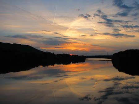 river county: Sunset over the west branch of the Susquehanna River on Maynard Street bridge, Williamsport, Lycoming County, Pennsylvania.