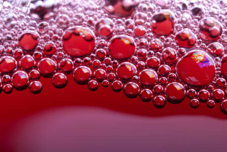 Bubbles of red wine from the different foreshortening  in glass Stock Photo - 13450096