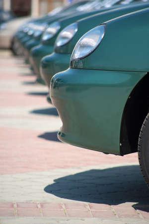 Row of brand new cars at a car dealership. photo