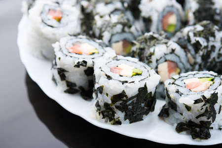 Delicious sushi with salmon, avocado and shrimp photo