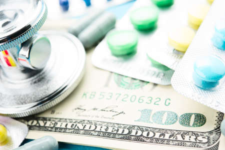 Concept of medicine and money photo