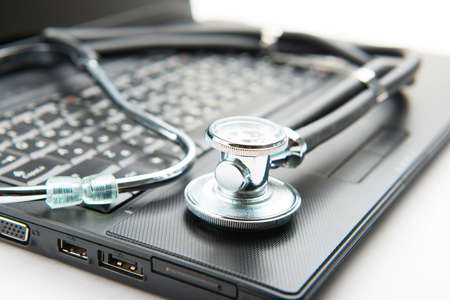 computer support: Concept of diagnostic. Stethoscope and laptop Stock Photo