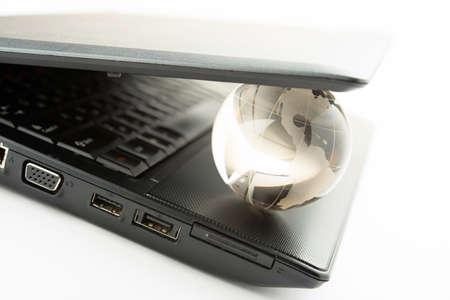 globe on a laptop keyboard photo