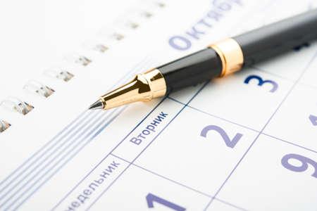 calender: Setting a date. Calendar and pen.