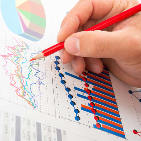 Analyse company year report with graphs and pencil Stock Photo - 15098083