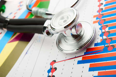 red stethoscope: Stethoscop on a statistics graphic Stock Photo