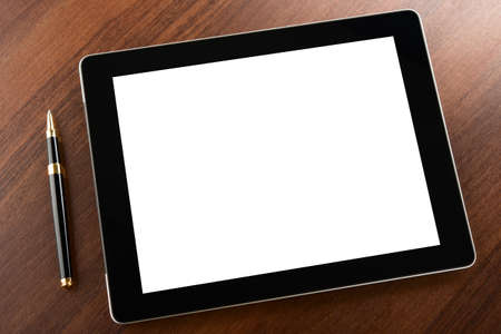 Tablet computer with blank screen on a businessman workplace