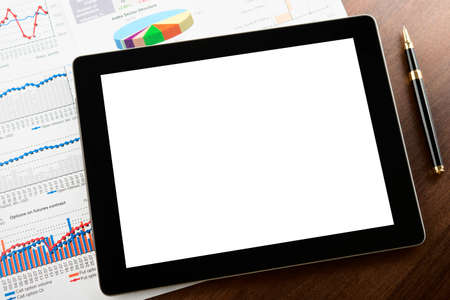 Tablet computer with blank screen on a businessman workplace Stock Photo - 15374581