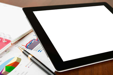 Tablet computer with blank screen on a businessman workplace Stock Photo - 15374555