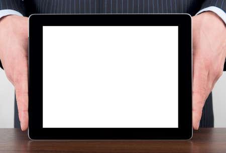 Man holding blank digital tablet on a desk Stock Photo - 15991688