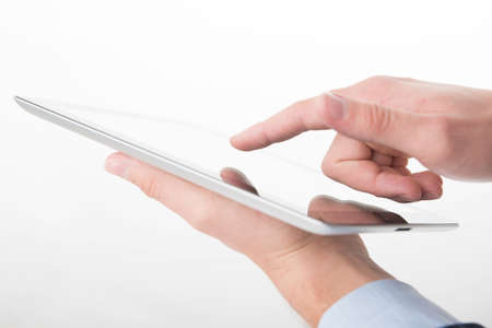 Young man working on a digital tablet
