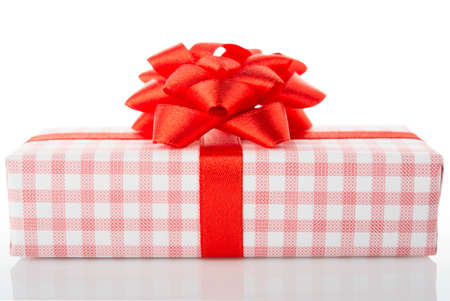 goodie: Vintage gift box with red bow, isolated on white background