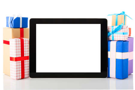 Tablet pc with gift boxes isolated on white background photo