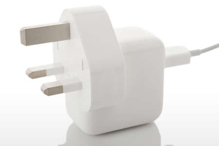 tine: White electric plug on a hite background with reflection Stock Photo