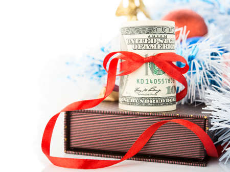 Money, gift box and Christmas decorations on white background. photo