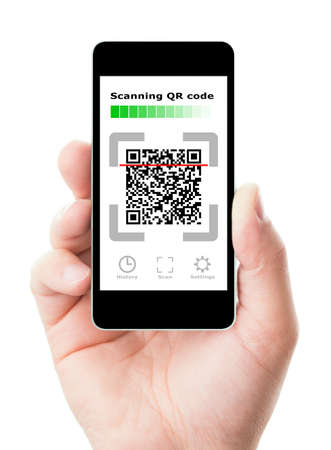 Smartphone in hand scanning QR code Standard-Bild