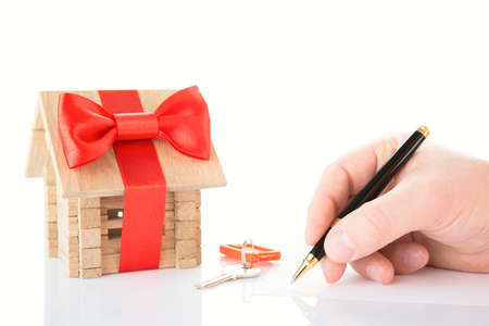 refinance: Businessman signs of the real estate contract Stock Photo