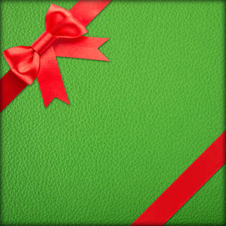 red bow and ribbon over red wrapped gift photo