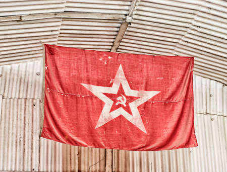 totalitarian: flag red star sickle and hammer .