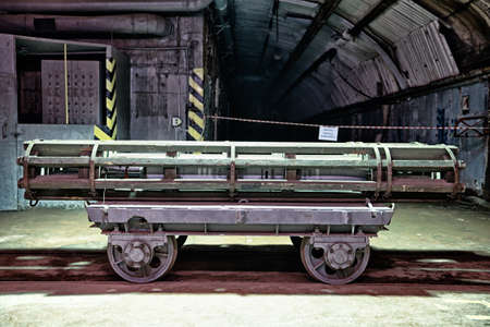 gun shell: gun shell on a transport cart .