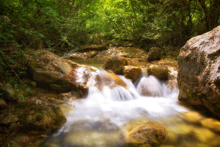 Small waterfall on mountain river in Crimea photo