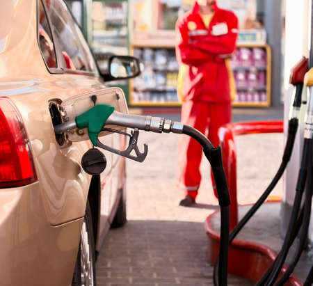 fuel economy: Car refueling on a petrol station . Stock Photo