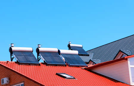 solar panel roof: Contemporary hot water panels on a house