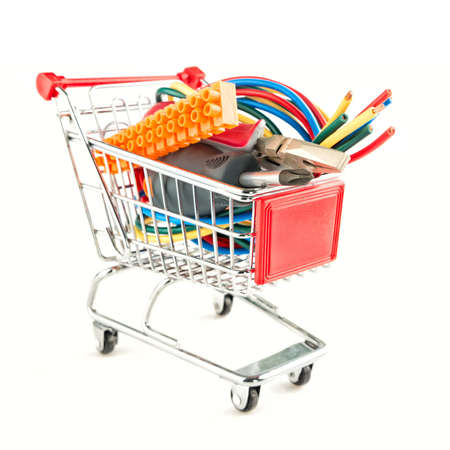 shopping cart with electric tools on white background Stock fotó