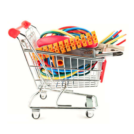 shopping cart with electric tools on white background Stock Photo
